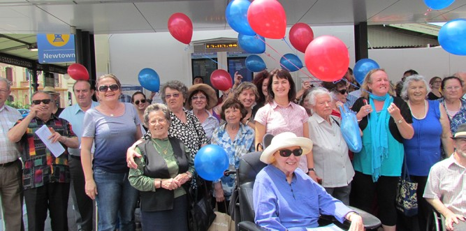 Carmel Tebbutt with excited commuters at Newtown Station (Photo: Lisa Burns)