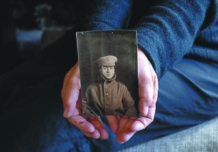 Miranda Bridge holds a picture of her grandfather Albert Kyle. Photo: Vedat Acikalin