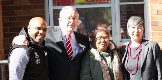 Tenants with Brad Hazzard (second from left) and Jenny Leong (right) at the RedLink opening. Photo: Geoff Turnbull