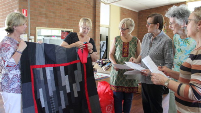 Left to right: Linda Burnett, Dale Snell, Sue Zanco, Diana Whitton, Daphne Massie and Jan Cooley share sewing tips as they prepare to bind the edges of quilts for Annie Green Court Photo: Lyn Turnbull