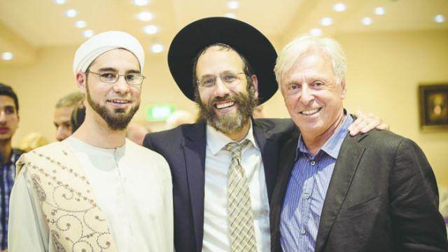 Rabbi Zalman Kastel (centre) with Sheikh Ahmed Abdo and Robert Magid Photo: Supplied
