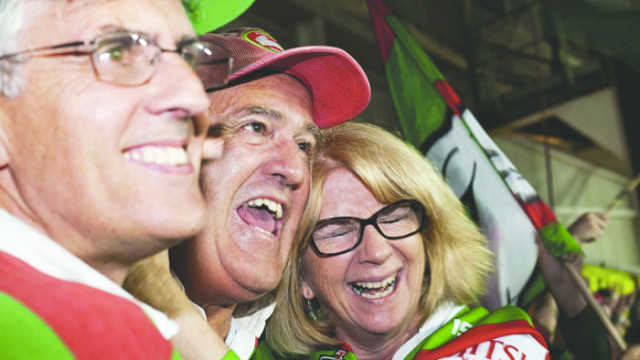 Michael Page (left) with friends at the NRL grand final, 2014  Photo: Jennifer Blau