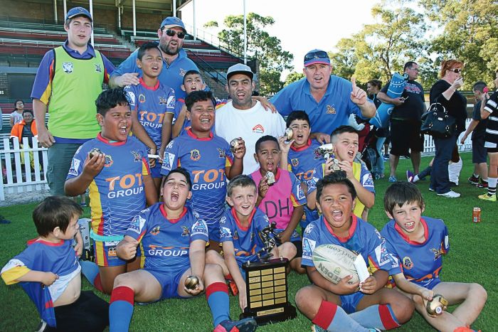 The victorious St Johns Eagles celebrate with Nathan Merritt (white T-shirt). Photo: Frank Trostel