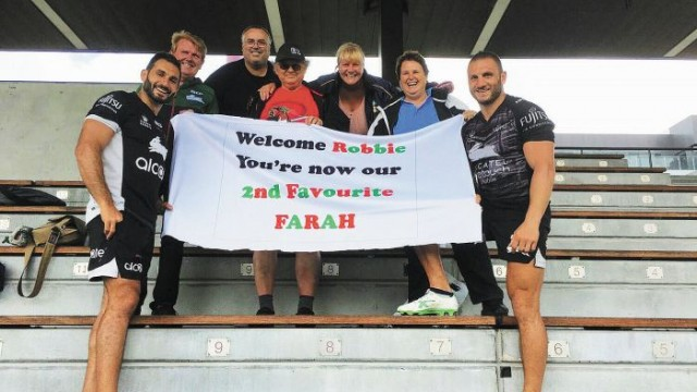 Eddie and Robbie Farah with fans at Redfern Oval. Photo: Supplied