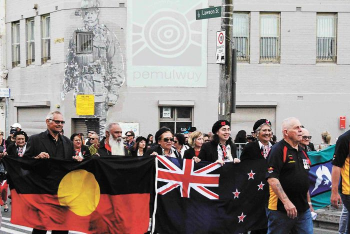 Koori and Kiwi marchers with their respective flags at the 11th Coloured Diggers march in Redfern. Photo: Lyn Turnbull