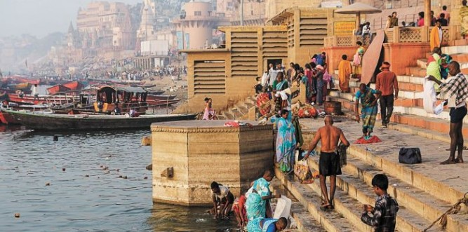 Early in the morning at Varanasi, Hindu pilgrims flock to the ghats to take a dip in the holy Ganges. Photo: Claire Mahjoub