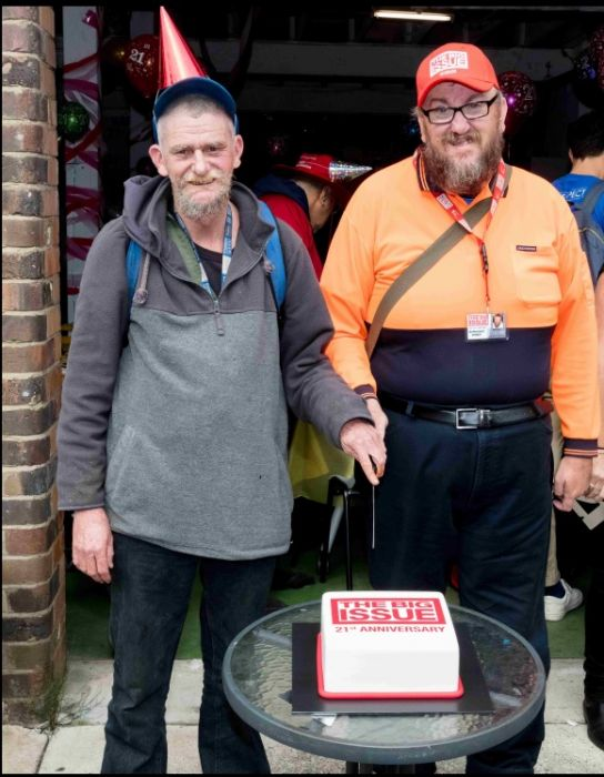 Long serving vendors David S & Marcus cut the cake Photo: Peter Holcroft