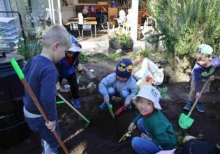Sunbeam preschoolers prepare the soil for planting Photo: Lyn Turnbull