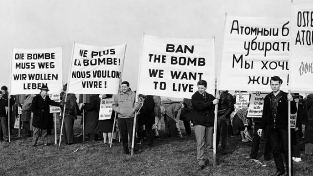 Demonstrators displaying signs in German, French, English, and Russian near a future rocket range in Bavaria, Germany, 1961. Photo: AP Photo/Lindlar