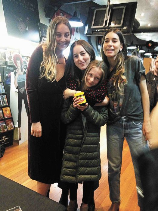 Este, Alana and Danielle Haim at Hum on King with Ava, 10, who presented the trio with a jar of Vegemite Photo: KJ Thiele
