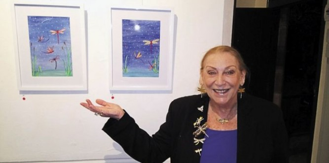 Carolynne Miller with two of her artworks at the Orchard Gallery Photo: Miriam Pepper