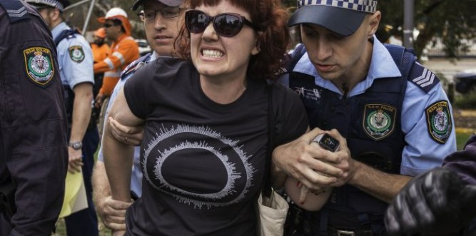 Protester held by cops Photo: Jack Carnegie