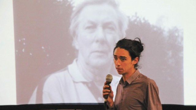 Thomas Chailloux with projected image of Ross Smith (the gathering marked the first anniversary of Ross's death) Photo: Lyn Turnbull