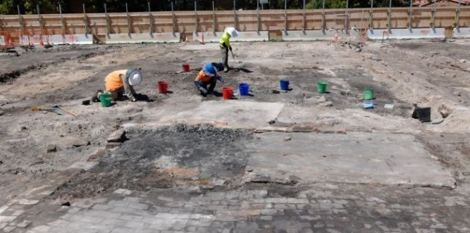 Archaeologists collect and sift soil samples at the site (facing Cope Street). Photo: Andrew Collis