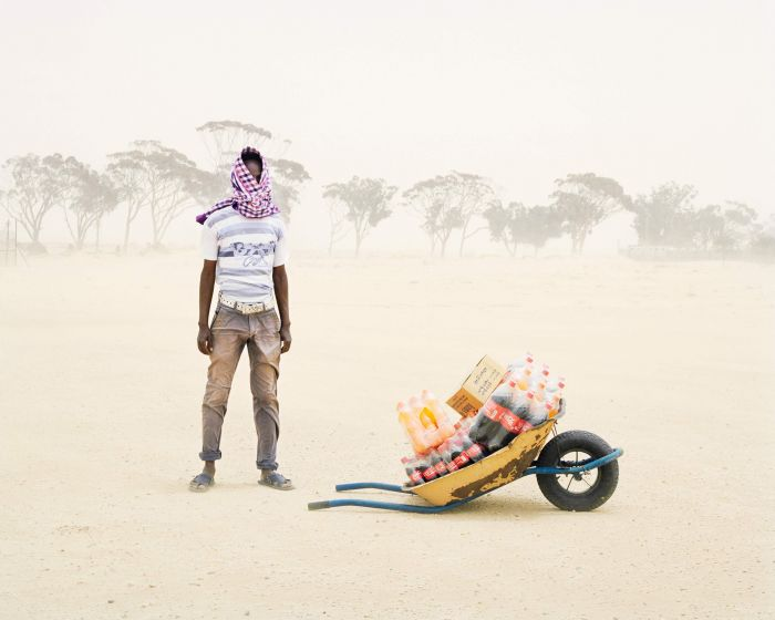 Severe sandstorms lash a man in Choucha refugee camp, Tunisia. Image: Samuel Gratacap, Empire, refugee camp of Choucha, Tunisia, 2012–14 (Courtesy of the artist and Gallery Les filles du calvaire, Paris)