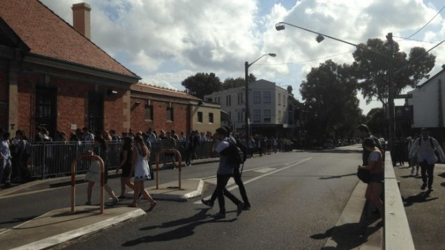 Afternoon rush at Redfern station as students overflow the footpath and spill onto Lawson Street. Photo: Lyn Turnbull