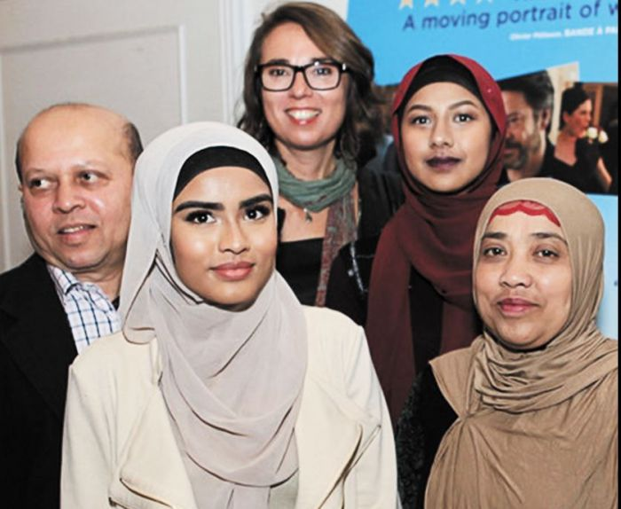 Director Michi Marosszeky pictured with Rohingyan refugee Zainab and her family and friends at the Woven Threads launch. Zainab, who featured in an episode, was born in Malaysia but came to Australia with her parents at the age of 3 and now, at the age of 16, is thankful for the journey her parents made to give her a safer life. Image: supplied