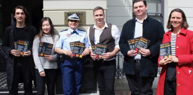 Staff and student volunteers from Redfern Legal Centre (RLC) with Redfern Local Area Command Crime Manager Detective Inspector Despa Fitzgerald, holding copies of the new the multi-language factsheet on sexual assault, Your Body, Your Choice. L-R: RLC student volunteers, Jevan and Lauren, Redfern Local Area Command Crime Manager, Detective Inspector Despa Fitzgerald, RLC International Student Solicitor Sean Stimson, RLC student volunteer Adrian, and RLC CEO Jo Shulman. Photo: Finn O'Keefe
