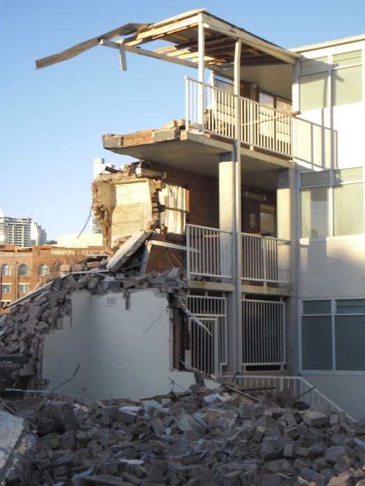 Demolition of buildings at Cowper St Glebe. Photo: Denis Doherty