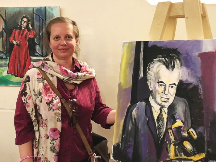 Waterloo artist and teacher, Grace Wilkinson, with her portraits of Gough Whitlam and Nana Mouskouri. Photo: Marjorie Lewis-Jones