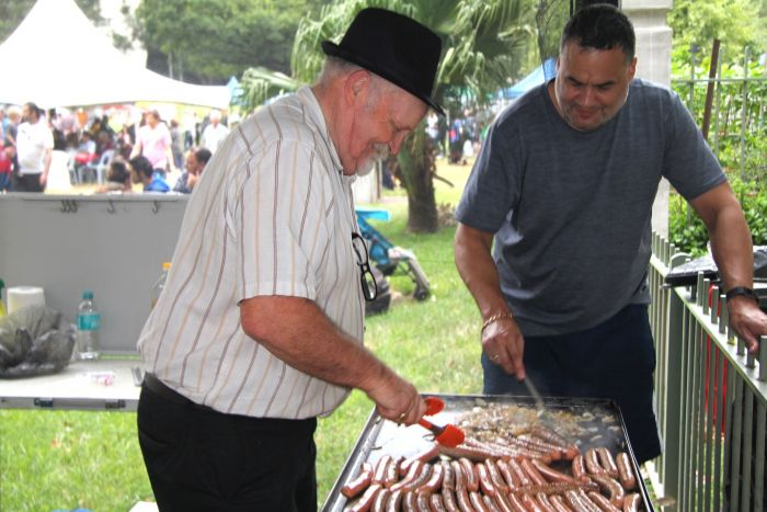 John Lanksy and Anthony Dillon kept up the supply of sausages and onions for the hungry crowd. Photo: Lyn Turnbull